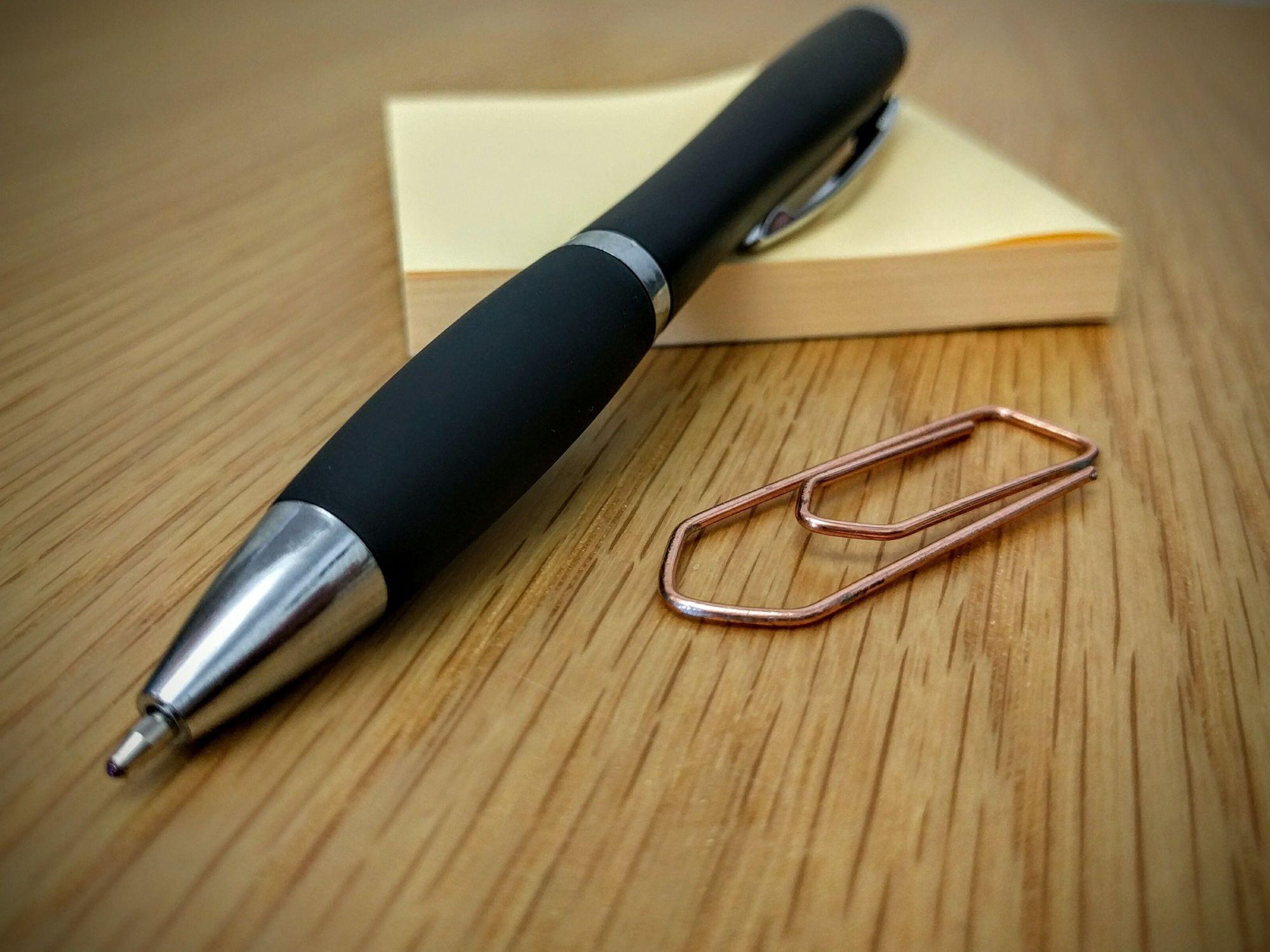 post-it, a pen, and a paper clip